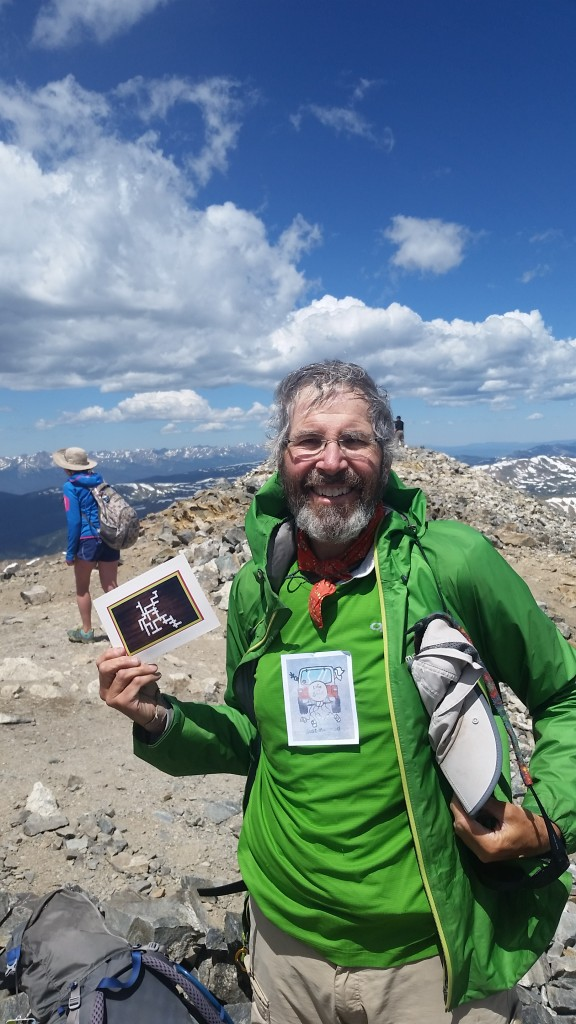 On the summit of Grays Peak with my Anniversary card from Cindy!