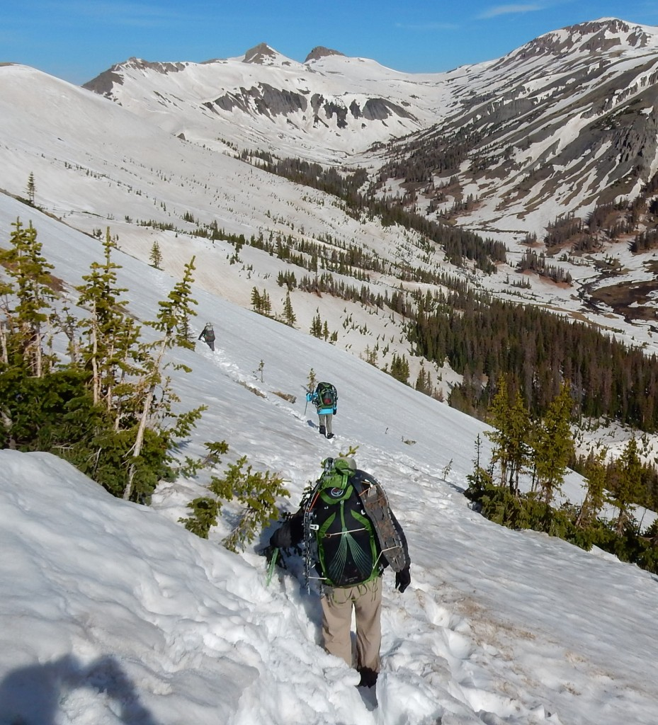 CDT hikers Paul, Chantal and Freebird traverse the snowy ridge above Adams Fork Conejos River, San Juan National Forest, Colorado on June 6.